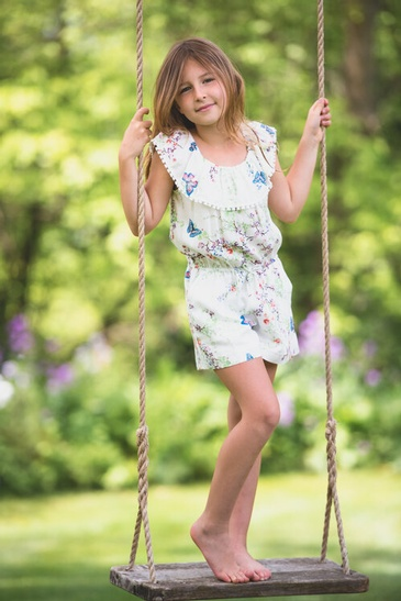 Young Girl Standing on a Swing Captured by Devon Crowell - Family Photography Guelph