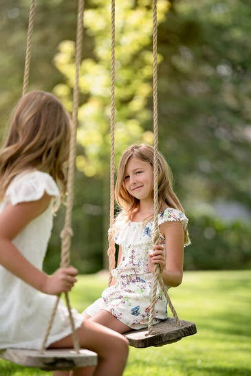 Siblings on Swing in a Park - Family Photography Burlington by Devon Crowell