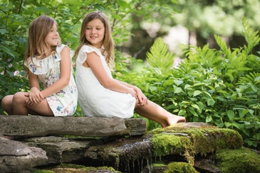 Sisters Sitting on Rock - Family Photography Burlington by Devon Crowell