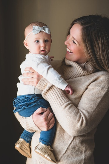 Happy Mother Holding her Child - Family Photography Hamilton by Devon Crowell