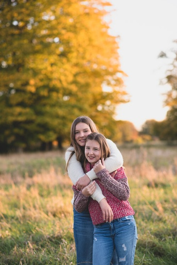 Siblings Hugging - Outdoor Family Photography Kitchener by Devon Crowell